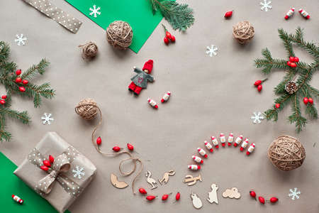 Flat lay, top view on craft paper background..Zero waste Christmas, concept flat layout on rustic wood. Hand crafted gifts, natural Christmas decorations without plastic, from biodegradable materials.