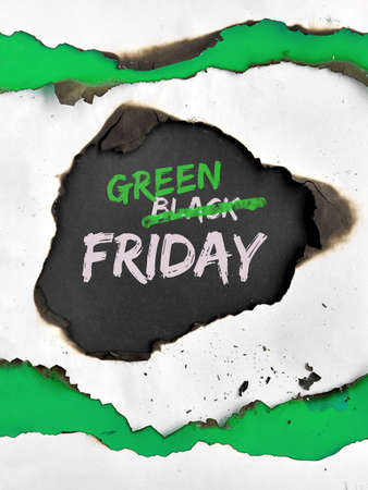 Green Friday concept, hole burned in white and green paper. Text