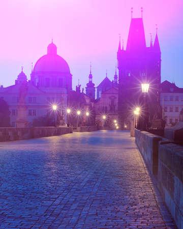 Prague at night, Charles Bridge, silhouette of Bridge Tower and saint sculptures with illumination in Prague, Czech Republic Banco de Imagens