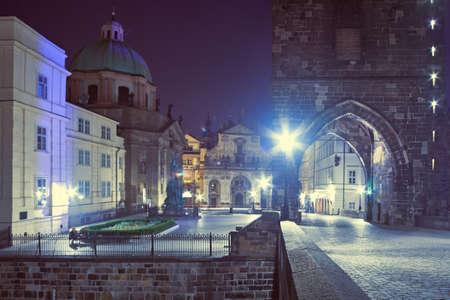 Prague at night, Charles Bridge, entrance through Bridge Tower with illumination in Prague, Czech Republic