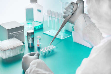 Novel coronavirus detection: pcr kit for rna of SARS-COV-2 novel coronavirus and rapid kit to detect antibodies for the virus in blood of recovered patients with COVID-19. Epidemiologist in test lab.
