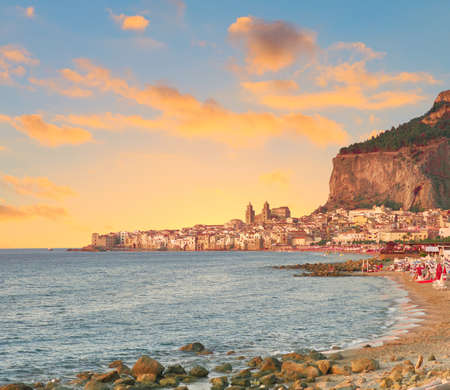 Glorious sunset over Cefalu, a town near Palermo, located on Tyrrhenian coast of Sicily, Italy. Cefalu is popular travel destination in Europe, for beach vacations