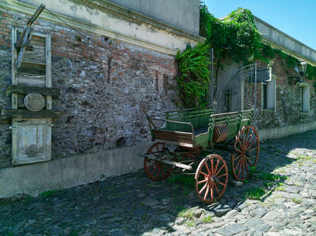 historical horse carriage in front of an ancient house in Colonia Uruguay