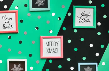 Abstract geometric Xmas background. Christmas greeting text and snowflakes in frames. Diagonal background, layered overlapping green, black paper, geometric shapes.