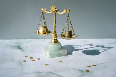 Cost of Christmas holidays concept. Weight scales, vintage gilded balance with stack of coins and Xmas trinkets. Stock fotó