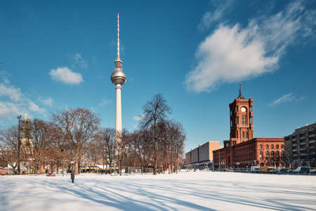 Berlin under snow. Panoramic image with television tower and Red Rathaus, or Old Town Hall in English.