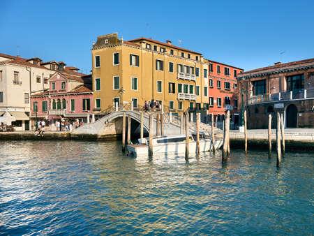 Rare visitors walk through foot bridge in Venice on a bright sunny day in Venice, Italy