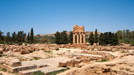 The temple of Castor and Pollux, Dioscuri brothers. It has only four columns left and has become the symbol of Agrigento. Valley of the Temples in Agrigento, Sicily, Italy.