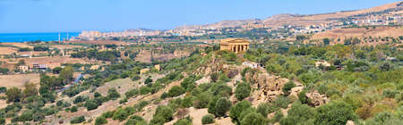Aerial bird view, Valley of of Temples, Agrigento, Sicily, Italy, with Temple of Concordia in the middle. Summer sunny day, blue sky, panoramic banner image.