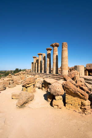Famous eight columns of the Temple of Heracles or Hercules, known as Tempio di Eracle in Italian. Valley of the Temples, Agrigento, Sicily, Italy.