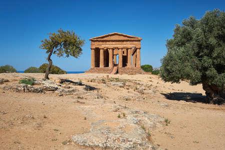 Temple of Concordia, or Tempio della Concordia in Italian. Temple building with olive trees. Valley of Temples, Agrigento, Sicily, Italy.