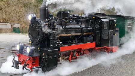 Historical steam train on end station in Gohren, island Rugen, Germany