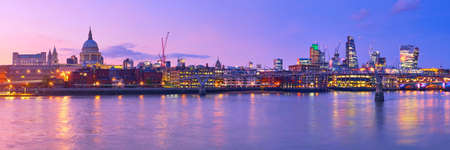 Millennium Bridge leading to Saint Paul's Cathedral in central London, England, on a sunset