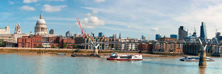 London, panoramic view over Thames river with Millennium bridge, St. Paul and London skyline