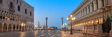 Banner, San Marco square at night, early morning. Venice or Venezia city, Italy, Europe. Panoramic composition, illuminated architecture, blue and yellow colors.
