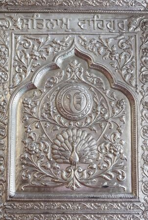 Carving on the door of a Sikh Temple in India