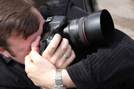 photojournalist: Photographer in close-up