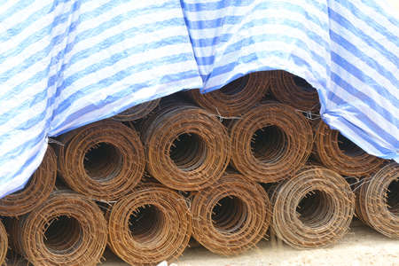 Rolls of wire mesh placed them in storage awaiting disposal