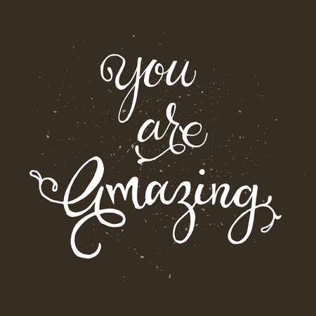 whimsical: Handwritten lettering phrase You are awesome. Brush lettering calligraphy style writing. Whimsical letters on dark chalkboard looking scratched textured surface.