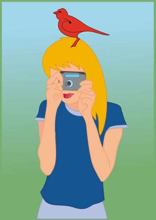Joven de la cámara en sus manos y el pájaro rojo en la cabeza  Foto de archivo - 7491313