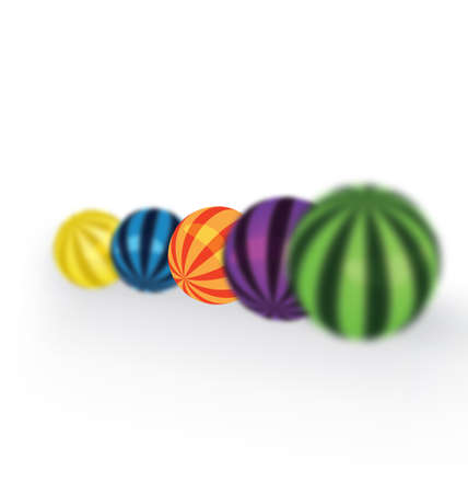 Colorful balls on a row with shallow depth of field