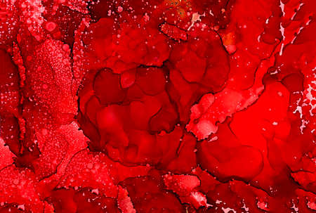 Abstract bright deep red texture.Colorful background hand drawn with bright inks and watercolor paints. Color splashes and splatters create uneven artistic modern design.