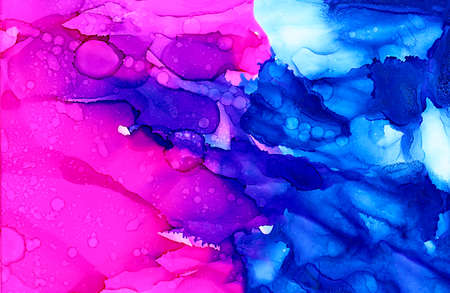 Abstract bright pink with textured blue.Colorful background hand drawn with bright inks and watercolor paints. Color splashes and splatters create uneven artistic modern design.