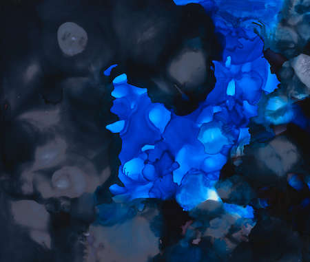 Bright black and blue uneven paint.Colorful background hand drawn with bright inks and watercolor paints. Color splashes and splatters create uneven artistic modern design.