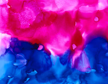 Bright pink deep blue cloudy texture.Colorful background hand drawn with bright inks and watercolor paints. Color splashes and splatters create uneven artistic modern design.