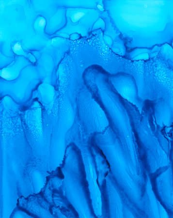 Uneven blue paint fluid texture.Colorful background hand drawn with bright inks and watercolor paints. Color splashes and splatters create uneven artistic modern design. Stock fotó