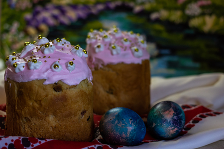 Happy Easter. Easter Cake - Russian and Ukrainian traditional kulich and colorful eggs on an embroidered towel Stock Photo