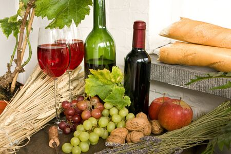 bread and wine: Fruits, bread, wine, nuts on a wine barrel
