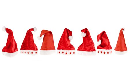 pompon: Seven red santa hats in various positions