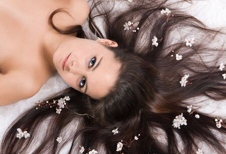 Seductive portrait of a beautiful young woman with spring blossoms in her hair Stock Photo - 3705562