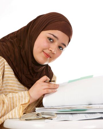 purdah: Young islamic office worker browsing through her files