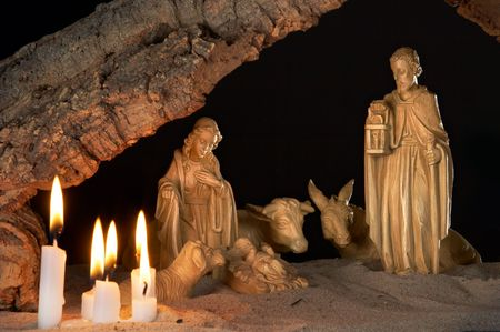 Very old christmas crib with cork roof and candles Stock Photo - 3707468