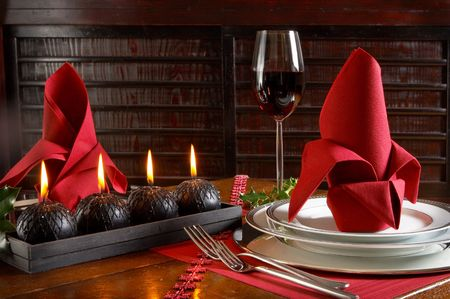 Christmas table in tones of red and black photo