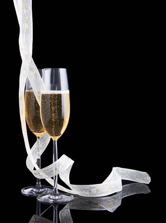 Elegant glasses of champagne and a white christmas ribbon