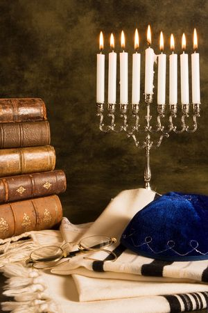 Nine candles for hanukkah, and a prayer shawl photo