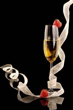 New Year champagne with christmas ribbons and strawberries