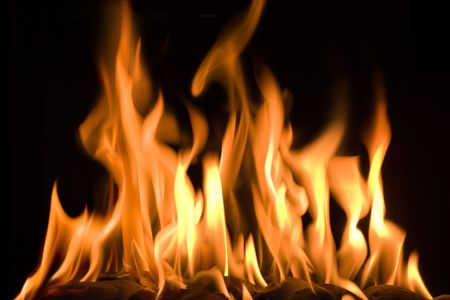 hell fire: Large camp fire against a dark background Stock Photo