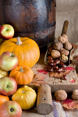Plenty of autumn food on an antique wooden board Stock Photo - 3727601