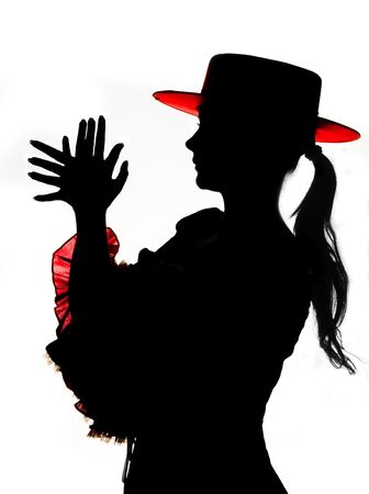 Silhouette (no photoshop rendered product) of a Spanish flamenco dancer photo