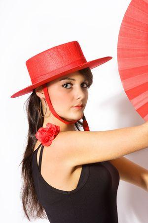 Young beautiful Spanish flamenco dancer in classical pose photo