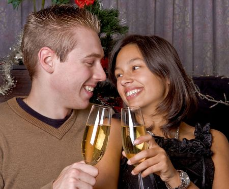 Young happy couple drinking champagne with christmas or new-year photo
