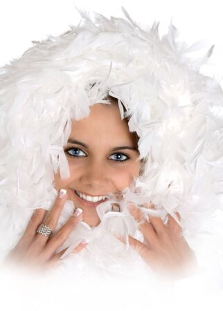 highkey: High-key portrait of an attractive young woman with winter feathers