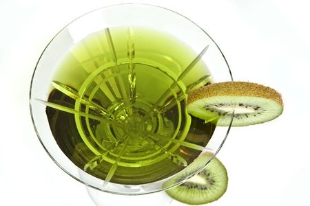 Green cocktail decorated with a slice of kiwi photo