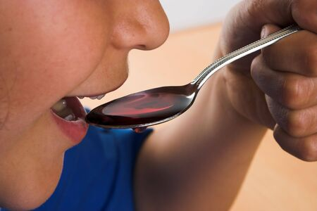 Boy taking a syrup on a spoon Stock Photo - 3714712