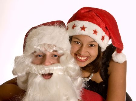 Happy brunette embracing her boy-friend in santa costume with christmas Stock Photo - 3714724