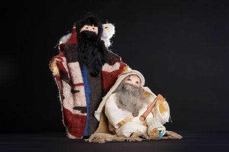Two figures of the christmas stable : sheperds and a sheep (handmade by a teenager) Stock Photo - 3727628